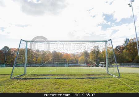 football goal on field stock photo, sport and equipment concept - football goal on field by Syda Productions