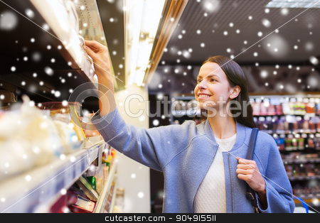 happy woman choosing and buying food in market stock photo, sale, shopping, consumerism and people concept - happy young woman choosing and buying food in market over snow effect by Syda Productions