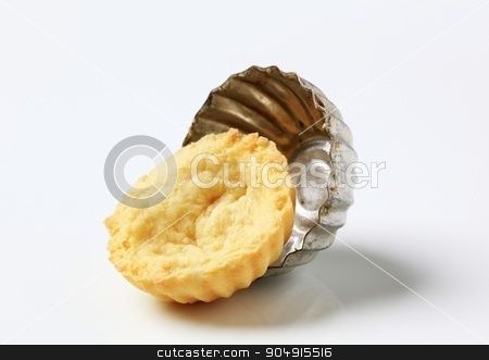Tart shell and baking mold stock photo, Shortcrust pastry and baking mold by Digifoodstock