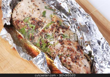 Grilled pork tenderloin stock photo, Spiced pork tenderloin grilled in tin foil  by Digifoodstock