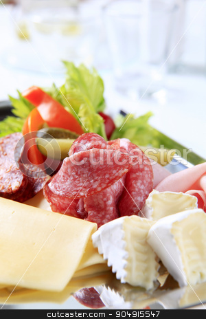 Tray of cold cuts stock photo, Slices of cheese, ham and salami on a tray by Digifoodstock