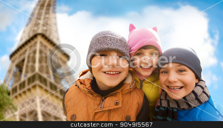 group of happy children hugging over eiffel tower stock photo, childhood, tourism, travel, vacation and people concept - group of happy kids over eiffel tower and sky background by Syda Productions
