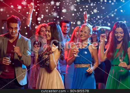 smiling friends with wine glasses and beer in club stock photo, new year party, holidays, celebration, nightlife and people concept - smiling friends clinking glasses of non-alcoholic champagne and beer in club and snow effect by Syda Productions