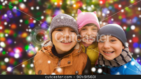 happy children over snow and christmas lights stock photo, childhood, leisure, friendship and people concept - group of happy kids hugging over snow background and lights by Syda Productions