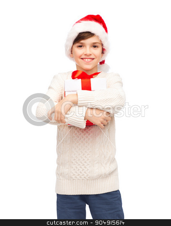 smiling happy boy in santa hat with gift box stock photo, holidays, presents, christmas, childhood and people concept - smiling happy boy in santa hat with gift box by Syda Productions