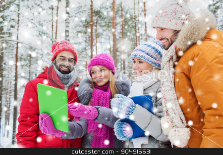 smiling friends with tablet pc in winter forest stock photo, technology, season, friendship and people concept - group of smiling men and women with tablet pc computers in winter forest by Syda Productions