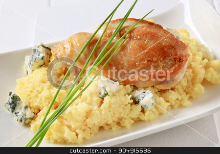 Chicken with couscous and blue cheese stock photo, Seared chicken breast served with couscous and blue cheese by Digifoodstock