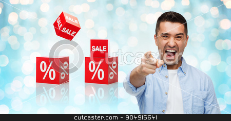 angry man shouting and pointing finger on you stock photo, shopping, sale, discount, gesture and people concept - angry man shouting and pointing finger on you over blue holidays lights and red percentage signs background by Syda Productions