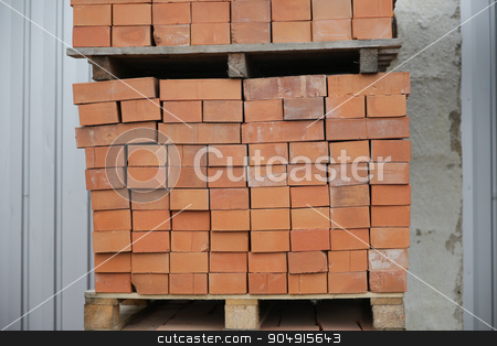 brown bricks batch on wooden storage tray stock photo, brickwork, construction and building material concept - brown bricks batch on wooden storage tray by Syda Productions