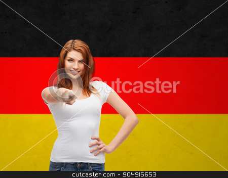 woman in t-shirt pointing at you over german flag stock photo, gestures, education, nationality and people concept - happy teenager in blank white t-shirt pointing at you over german flag background by Syda Productions