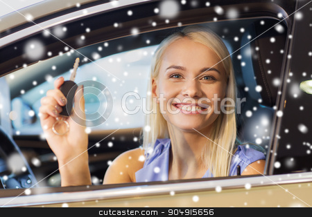 happy woman getting car key in auto show or salon stock photo, auto business, car sale, consumerism and people concept - happy woman taking car key from dealer in auto show or salon over snow effect by Syda Productions