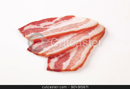 Cured bacon stock photo, Slices of cured bacon - studio shot by Digifoodstock