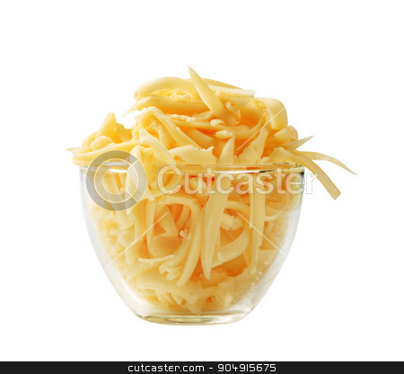 Grated cheese stock photo, Grated yellow cheese in a glass cup by Digifoodstock