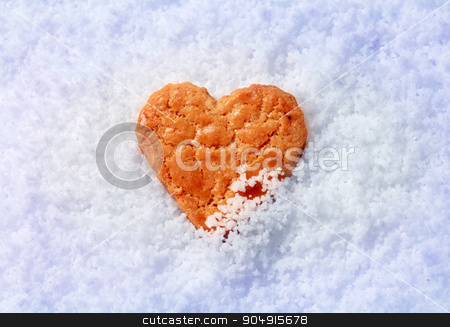 Heart shaped cookie in snow stock photo, Single heart shaped cookie in snow - detail by Digifoodstock