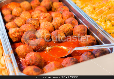 close up of meatballs and other dishes on tray stock photo, food, catering, self-service and eating concept - close up of meatballs and other dishes on metallic tray by Syda Productions