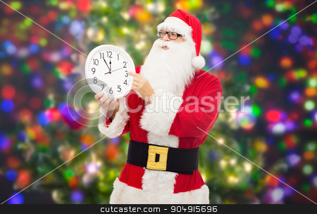 man in costume of santa claus with clock stock photo, christmas, holidays, time and people concept - man in costume of santa claus with clock showing twelve over party lights background by Syda Productions