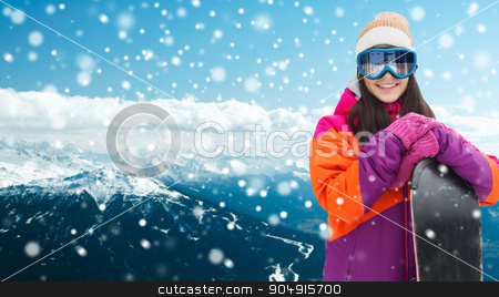 happy young woman with snowboard over mountains stock photo, winter, leisure, sport and people concept - happy young woman in ski goggles with snowboard over snowy mountain background by Syda Productions