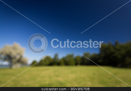 blurred summer field and blue sky background stock photo, nature, season, landscape and environment concept - blurred summer field and blue sky background by Syda Productions