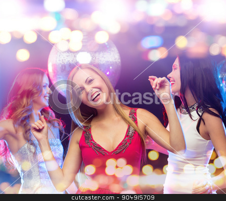 happy women dancing at night club stock photo, party, celebration, holidays, nightlife and people concept - happy women dancing at night club by Syda Productions