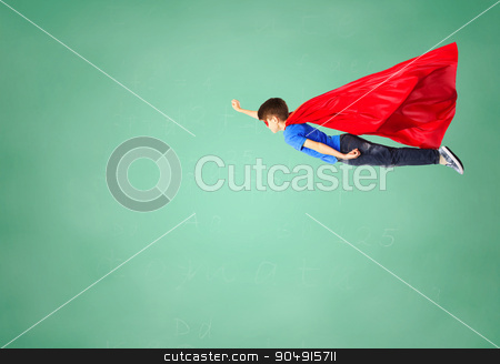 boy in red superhero cape and mask flying on air stock photo, freedom, childhood, education, movement and people concept - boy in red superhero cape and mask flying in air over green school chalk board background by Syda Productions