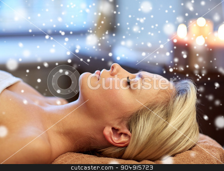 close up of smiling young woman lying in spa salon stock photo, people, beauty, spa, winter and relaxation concept - close up of beautiful smiling young woman lying with closed eyes in spa salon with snow effect by Syda Productions