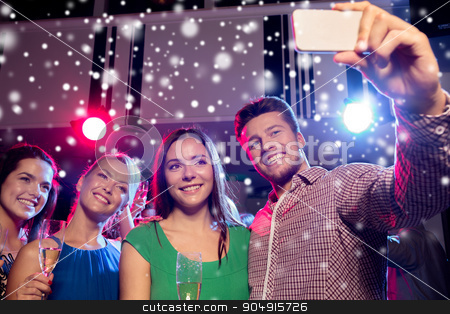 friends with glasses and smartphone in club stock photo, new year party, holidays, technology, nightlife and people concept - smiling friends with glasses of champagne and smartphone taking selfie in club and snow effect by Syda Productions