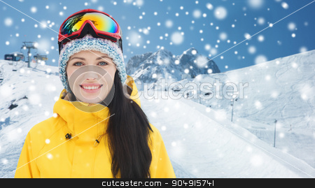 happy young woman in ski goggles over mountains stock photo, winter, leisure, sport and people concept - happy young woman in ski goggles over snow and mountain background by Syda Productions