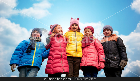 happy children hugging over blue sky background stock photo, childhood, leisure, friendship and people concept - group of happy kids hugging over blue sky background by Syda Productions