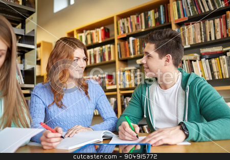 happy students with tablet pc in library stock photo, people, education, technology and school concept - happy students with tablet pc computer networking in library by Syda Productions