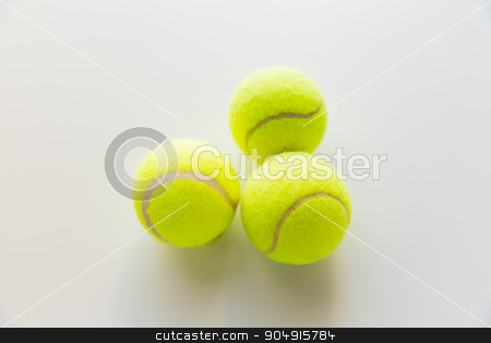 close up of three yellow tennis balls stock photo, sport, fitness, game and objects concept - close up of three yellow tennis balls by Syda Productions
