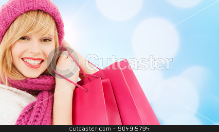 woman in pink hat and scarf with shopping bags stock photo, winter, people and happiness concept - woman in pink hat and scarf with many shopping bags by Syda Productions
