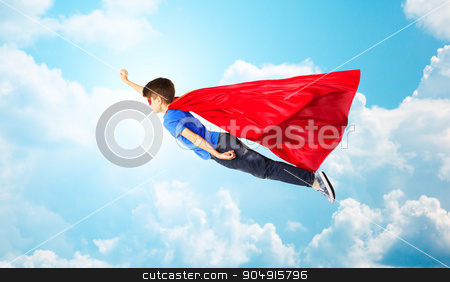 boy in red superhero cape and mask flying on air stock photo, imagination, freedom, childhood, movement and people concept - boy in red superhero cape and mask flying in air over blue sky and clouds background by Syda Productions