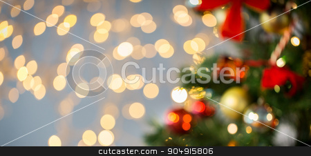 blurred christmas tree decorated with balls stock photo, holidays, new year, decor and celebration concept - blurred christmas tree decorated with balls and garland lights background by Syda Productions