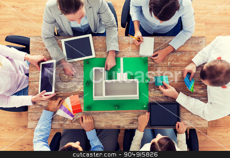 close up of business team with project layout stock photo, business, people and team work concept - close up of creative team with project layout, color palettes and tablet pc computers sitting at table in office by Syda Productions