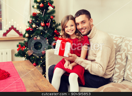 smiling father and daughter holding gift box stock photo, family, christmas, x-mas, winter, happiness and people concept - smiling father and daughter holding gift box by Syda Productions