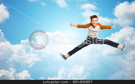 happy smiling boy jumping in air stock photo, happiness, childhood, freedom, movement and people concept - happy smiling boy jumping in air over blue sky and clouds background by Syda Productions
