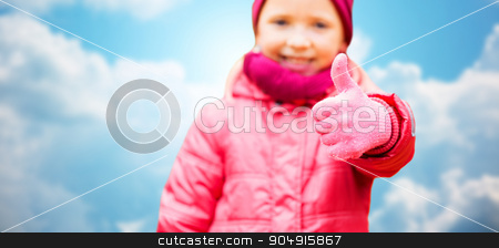 happy girl showing thumbs up over blue sky stock photo, autumn, childhood, gesture and people concept - close up of happy little girl showing thumbs up outdoors over blue sky background by Syda Productions