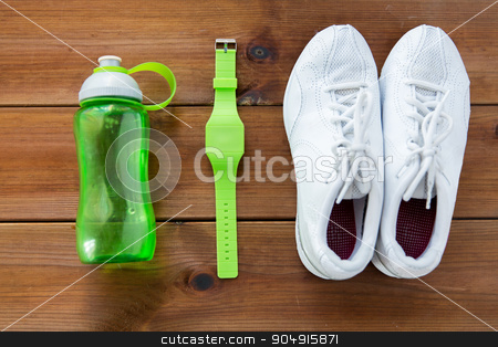 close up of sneakers, bracelet and water bottle stock photo, sport, fitness, healthy lifestyle and objects concept - close up of sneakers, bracelet and water bottle on wooden floor by Syda Productions