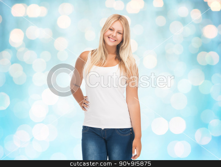 smiling young woman in blank white shirt and jeans stock photo, people, holidays, style and body type concept - smiling young woman in blank white shirt and jeans over blue holidays lights background by Syda Productions