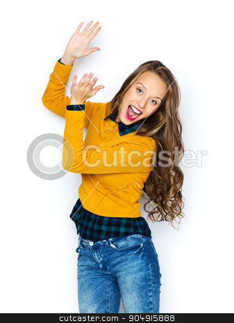 happy young woman or teen girl applauding stock photo, people, style and fashion concept - happy young woman or teen girl in casual clothes having fun and applauding by Syda Productions