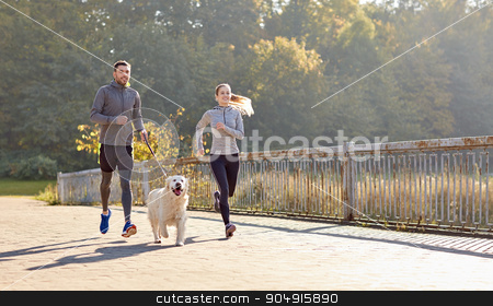 happy couple with dog running outdoors stock photo, fitness, sport, people and lifestyle concept - happy couple with dog running outdoors by Syda Productions