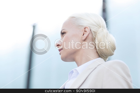 young businesswoman over office building stock photo, business, people and education concept - young businesswoman over office building by Syda Productions