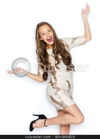 happy young woman or teen girl in fancy dress stock photo, people, style, holidays, hairstyle and fashion concept - happy young woman or teen girl in fancy dress with sequins and long wavy hair having fun by Syda Productions