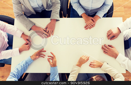 close up of business team sitting at table stock photo, business, people and team work concept - close up of creative team sitting at table in office by Syda Productions