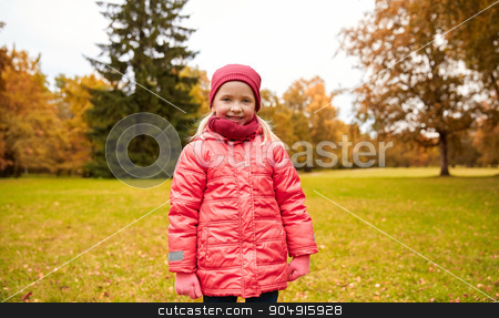happy little girl in autumn park stock photo, autumn, childhood, nature and people concept - happy little girl in park by Syda Productions