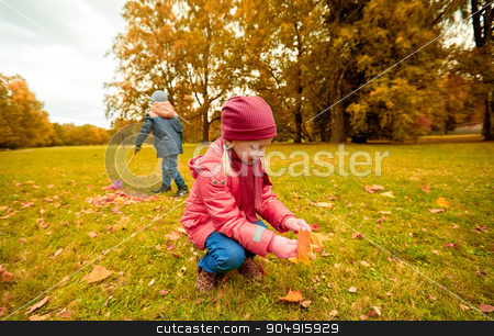 children collecting leaves in autumn park stock photo, childhood, leisure, friendship and people concept - little girl and boy with rack collecting and racking leaves in autumn park by Syda Productions