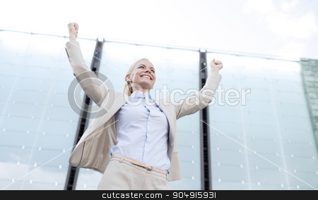 young smiling businesswoman over office building stock photo, business, people and education concept - young smiling businesswoman over office building by Syda Productions