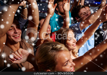 group of smiling friends at concert in club stock photo, party, holidays, celebration, nightlife and people concept - group of smiling friends waving hands at concert in club and snow effect by Syda Productions