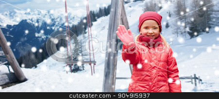 happy girl waving hand over winter background stock photo, childhood, gesture, winter holidays, vacation and people concept - happy little girl waving hand over swing and snowy mountains background by Syda Productions