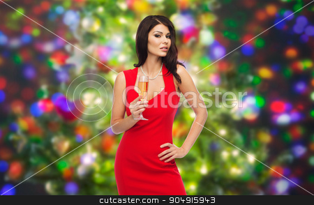 beautiful sexy woman with champagne glass stock photo, people, holidays, christmas and celebration concept - beautiful sexy woman in red dress with champagne glass over party lights background by Syda Productions